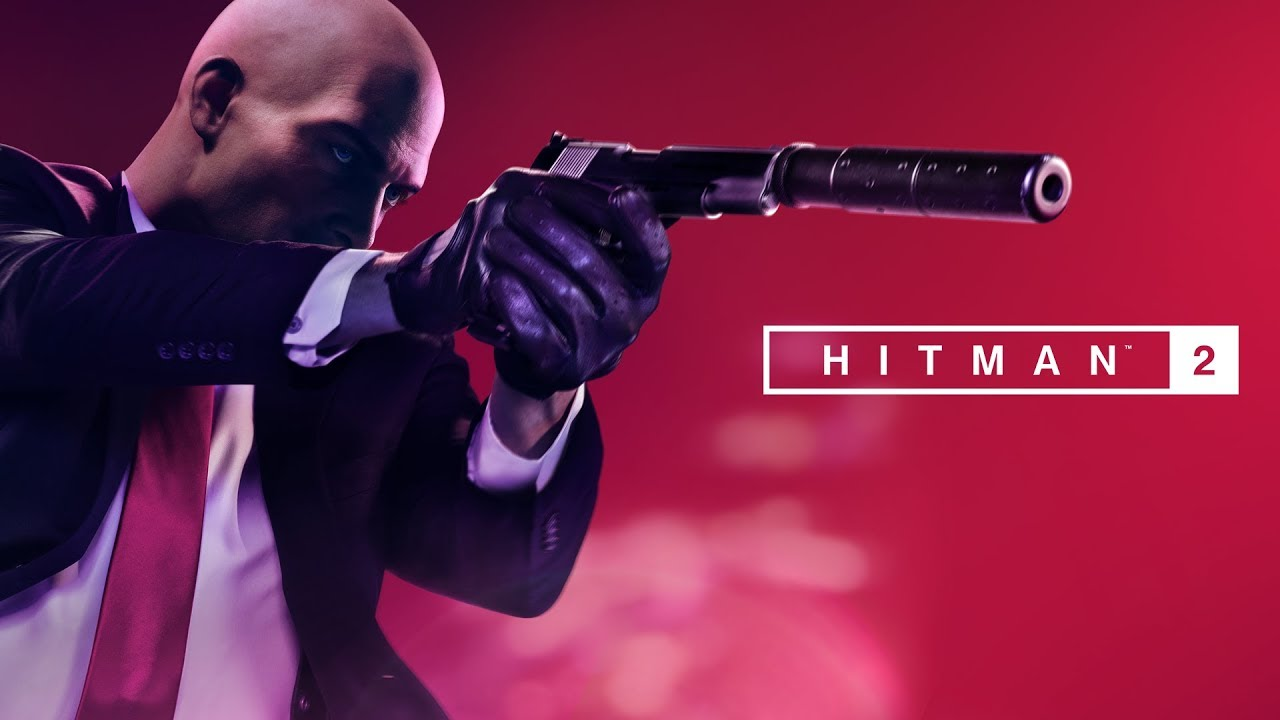 Hitman 2 logo with Agent 47 pointing a silenced pistol to the right
