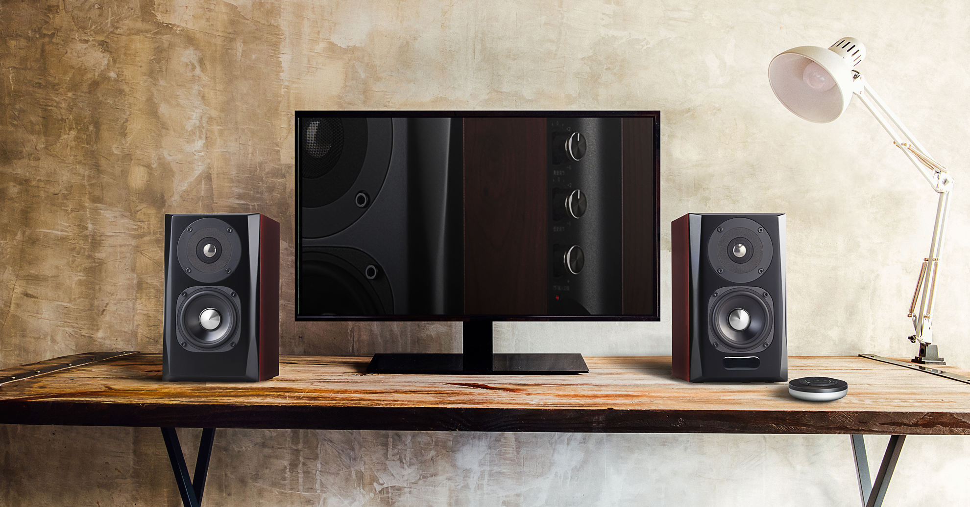 Edifier S350DB bookshelf speakers sitting both sides of a monitor