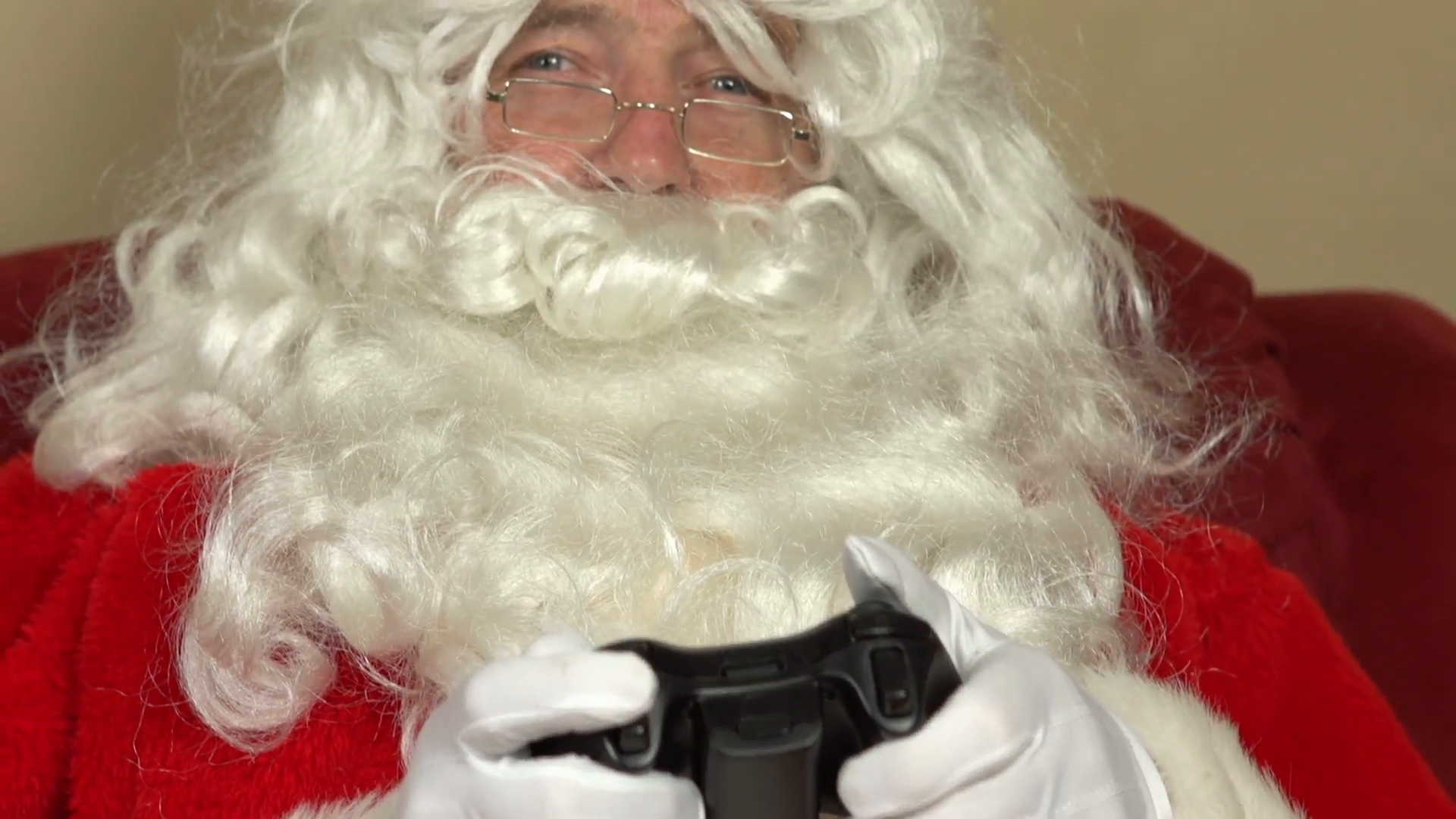 Santa playing video games at Christmas